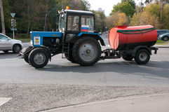 Watering tractor with a barrel of Belarus Royalty Free Stock Photography