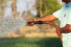 Watering the vegetable garden Stock Photos