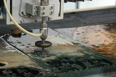 Waterjet l cutter royalty free stock images