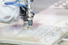 Waterjet metal cutting by cnc program Stock Images