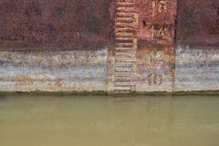 Waterline on old and rusty ship. Waterline indicates the draft of the ship and the legal limit to which a ship may be loaded for specific water types and royalty free stock photography