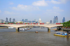 Waterloo Bridge and London City. View at the London City over the Waterloo Bridge with a long line of red buses, England, United Kingdom Royalty Free Stock Photos