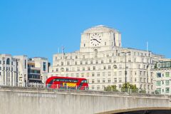Waterloo Bridge with a passing bus and facade of Shell Mex House in the background. In London stock image
