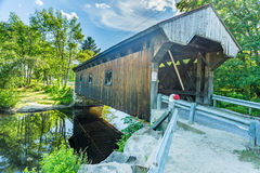 Waterloo Covered Bridge. The Waterloo Covered Bridge carries Newmarket Road over the Warner River near the Waterloo Falls in Warner, New Hampshire. The Town Stock Photo