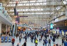 Waterloo station London. On a busy afternoon with the famous clock in the background Royalty Free Stock Photography