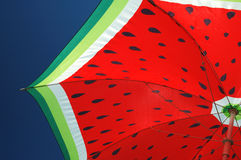 Watermellon umbrella. Beach umbrella against blue sky Stock Photo