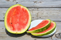 Watermellon. On the wooden background Royalty Free Stock Photos