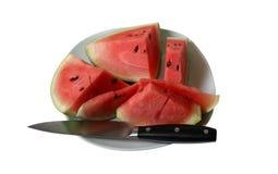 Watermeloen en Mes Stock Foto's