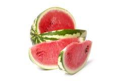 Watermeloen en plakken van watermeloen stock foto