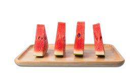 Watermeloen op houten plaat stock foto's