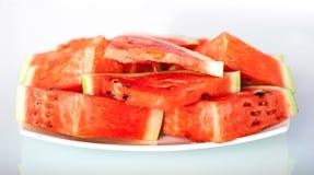 Watermeloen witte plaat Stock Foto