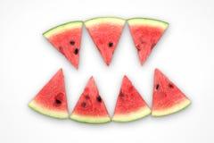 Watermeloenplakken als een demontanden worden geschikt op een witte achtergrond die Royalty-vrije Stock Foto's