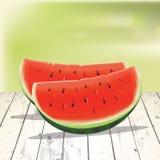 Watermeloenplakken op de houten lijst Royalty-vrije Stock Foto