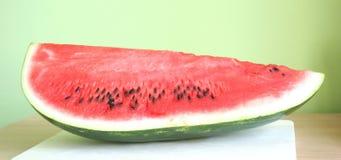 Watermelon. Fresh watermelon with green background Stock Photo