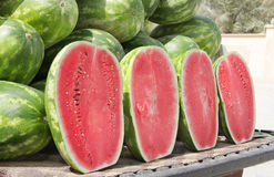 Watermelon. The watermelon fruit has a smooth exterior green and yellow cover with juicy sweet interior pink and orange flesh Royalty Free Stock Photography