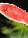 Watermelon. Close-up of a half cut ripe watermelon over black background Stock Image