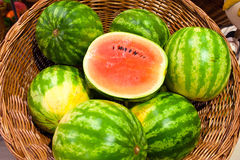 Watermelon. Ripe water-melons in a wattled basket Royalty Free Stock Photo