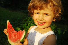 Watermelon. Beautiful four year old with sliced watermelon royalty free stock photo