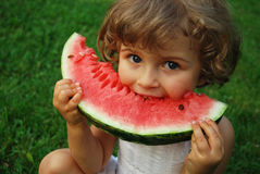 Watermelon. Beautiful four year old with sliced watermelon Royalty Free Stock Photography