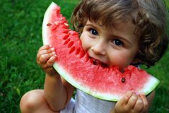 Watermelon. Beautiful four year old with sliced watermelon Stock Photography