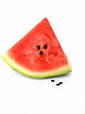 Watermelon. A big triangle piece of red fresh watermelon isolated on white background Stock Photo