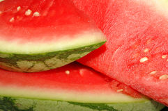 Watermelon. Background of brightly lit watermelon slices Royalty Free Stock Photos
