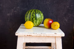 Watermelon apple and lemons on table Royalty Free Stock Photo