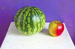 Watermelon and apple on seat Royalty Free Stock Photography