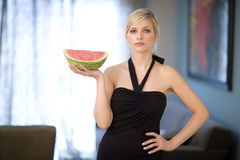 Watermelon Attitude. Beautiful young woman holds a slice of watermelon Royalty Free Stock Photography