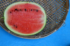 Watermelon on bamboo shallow tray Stock Images