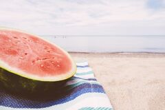 Watermelon on beach Stock Images