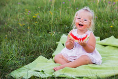 Watermelon. Beautiful two year old girl with sliced watermelon Royalty Free Stock Photos