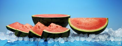 Watermelon on blue background. juicy summer fruit in slices Royalty Free Stock Images
