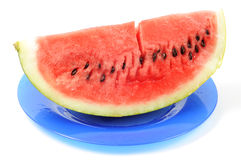 Watermelon on blue plate. Watermelon isolated on white background Stock Photo