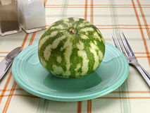 Watermelon on a blue saucer Stock Images