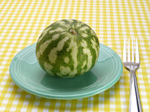 Watermelon on a blue saucer Stock Image