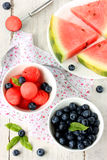 Watermelon and blueberries on a white background Stock Photography