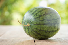watermelon on brown wooden background Royalty Free Stock Images