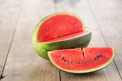 watermelon on brown wooden background Stock Photos