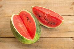 watermelon on brown wooden background Royalty Free Stock Image