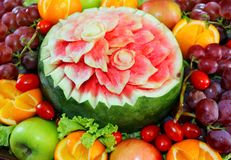Watermelon carved flower shape and fruits Royalty Free Stock Photo