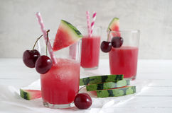 Watermelon-cherry smoothie. Fresh watermelon cherry smoothie in glass with straw Royalty Free Stock Photography