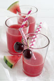 Watermelon-cherry smoothie. Fresh watermelon cherry smoothie in glass with straw Stock Photography