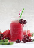 Watermelon-cherry smoothie. Fresh watermelon cherry smoothie in glass with straw stock photo