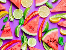 Watermelon and Chili pepper with lemons royalty free stock photography