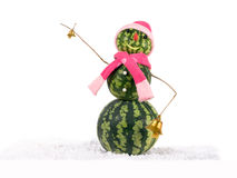 Watermelon christmas snowman with two golden bells in pink hat and scarf at snow. Holiday concept for New Years Royalty Free Stock Photos