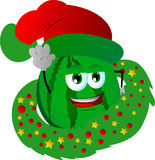 Watermelon with Christmas wreath and Santa hat Stock Photography
