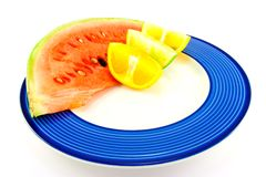 Watermelon with Citrus Wedges Stock Photo