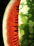 Watermelon close up. Appetizing watermelon isolated on black Royalty Free Stock Images