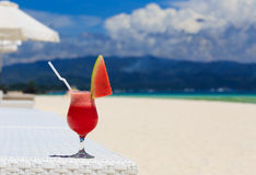 Watermelon cocktail on blue tropical beach Royalty Free Stock Photography